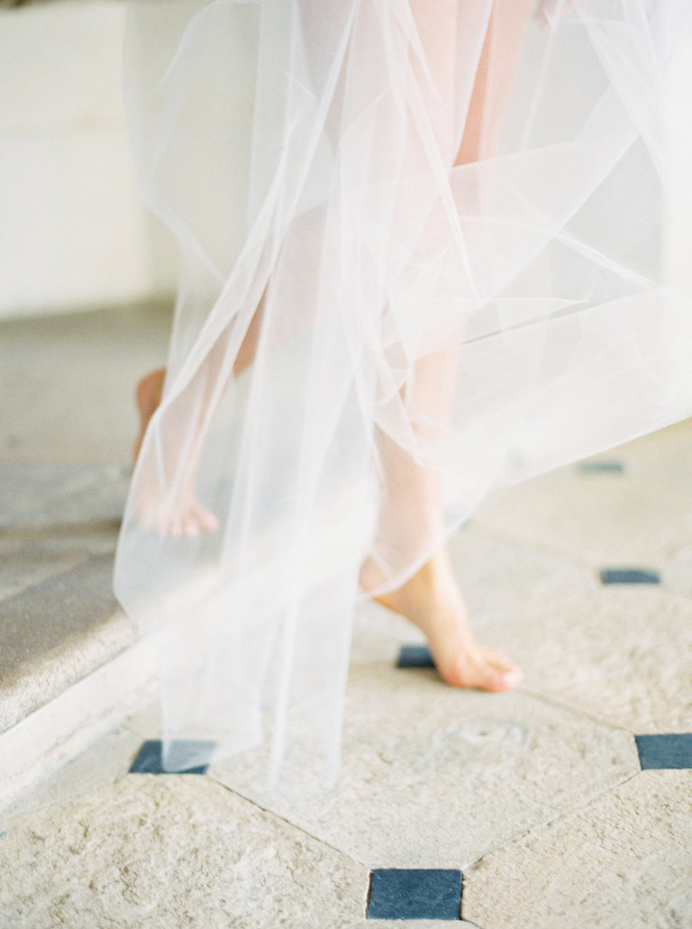 Wedding detail of legs and veil