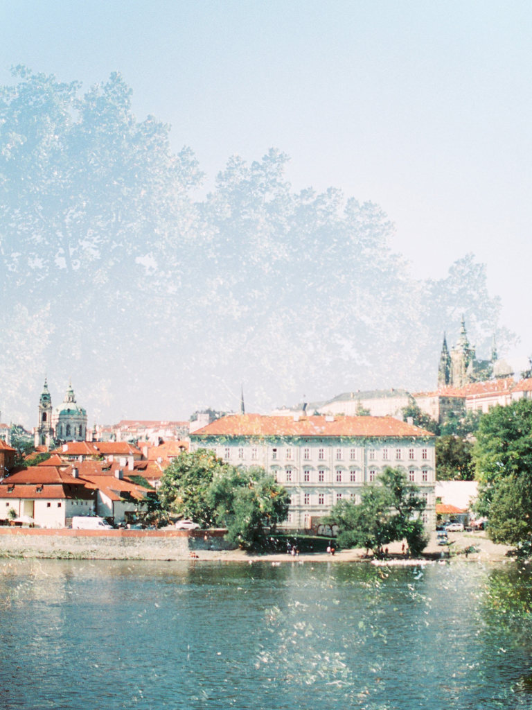 Double exposure of prague panorama on film camera