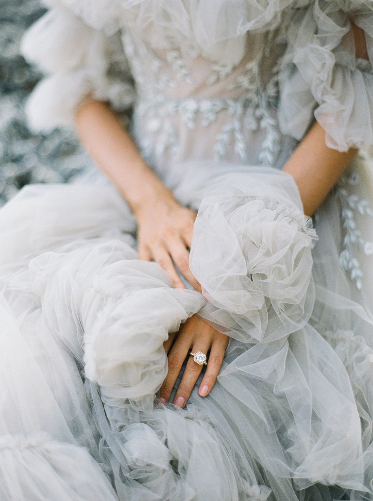 Wedding detail of grey wedding dress and luxury wedding ring