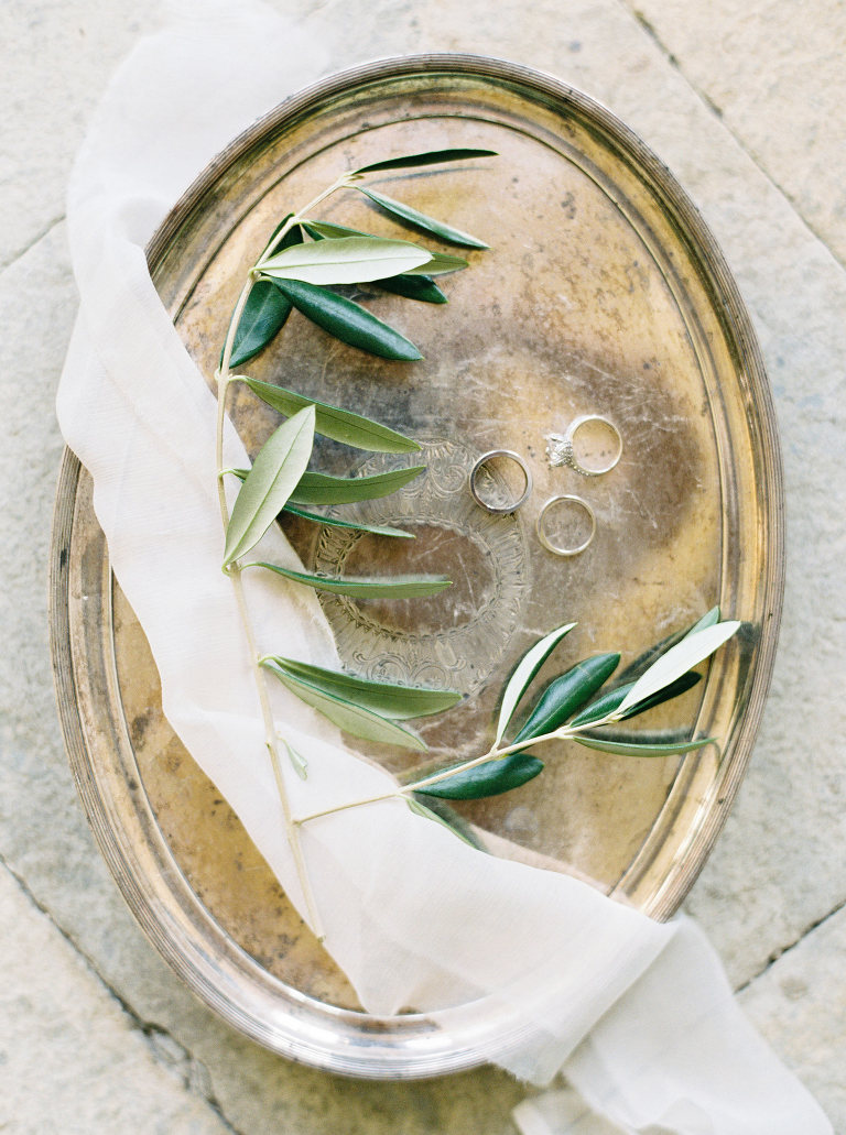 Wedding rings and olive on old italian tray